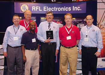RFL team proudly displaying the 2007 UTC Best Telecom Product Award.